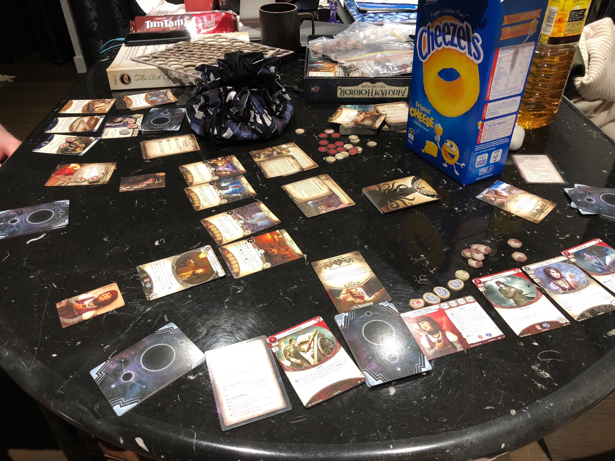 Table covered with cards and cardboard tokens